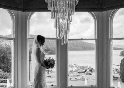 bride standing in window at Belsfield Hotel
