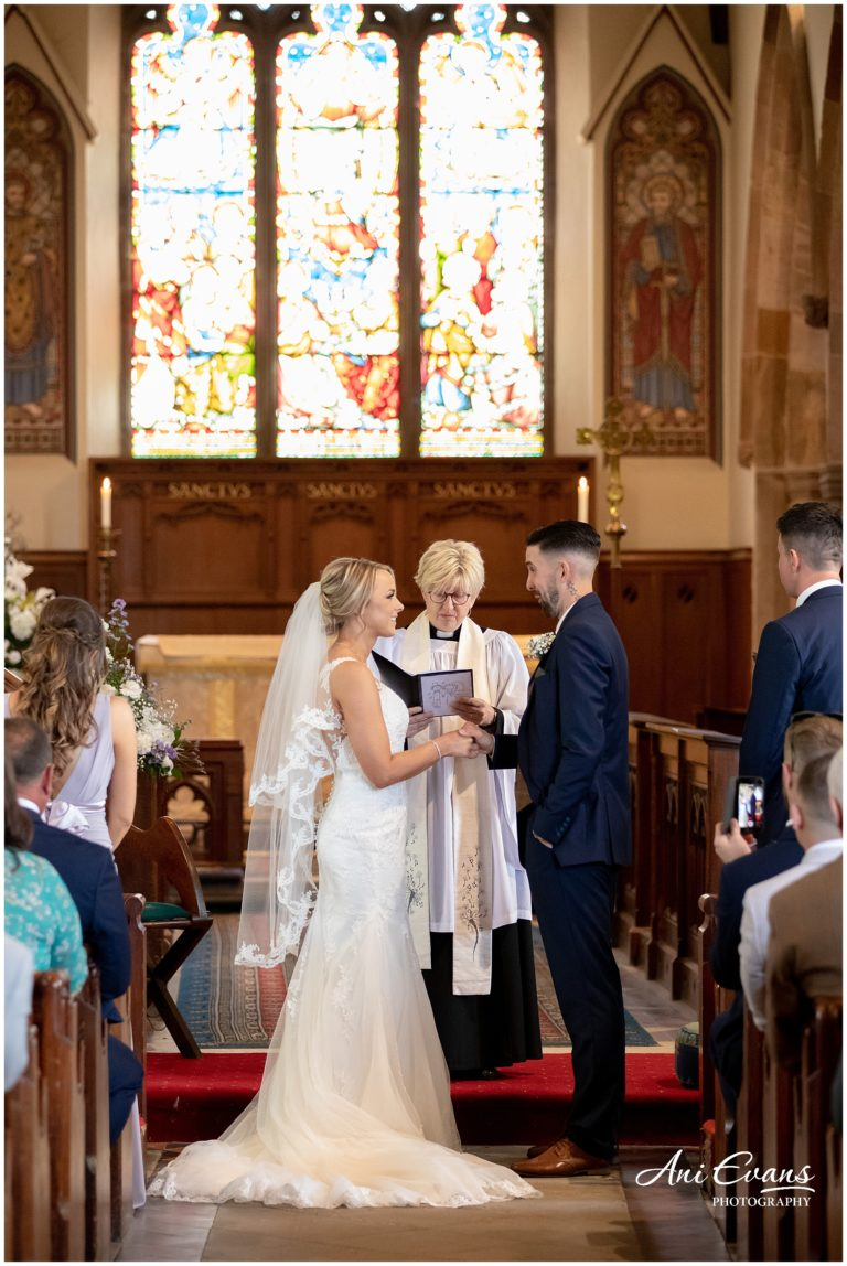 Bride and Groom exchange rings at Braunston Church