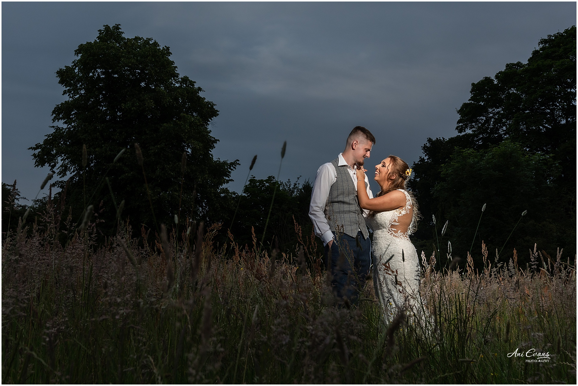 Bride and groom at Dunchurch Park at sunset time